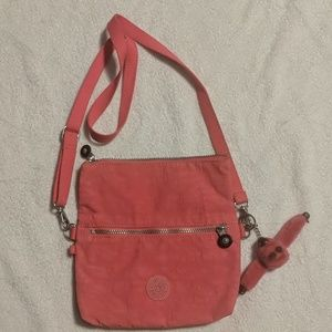 Hot pink Kipling purse with pink gorilla keychain